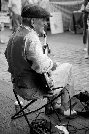 Musician busking at Lewes Farmer's Market